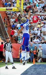 Jan 29, 2012; Honolulu, HI, USA; NFC tight end Jimmy Graham of the New Orleans Saints (80) dunks the ball over the cross bar after scoring a touchdown against the AFC during the 2012 Pro Bowl at Aloha Stadium. Mandatory Credit: Kyle Terada-US PRESSWIRE