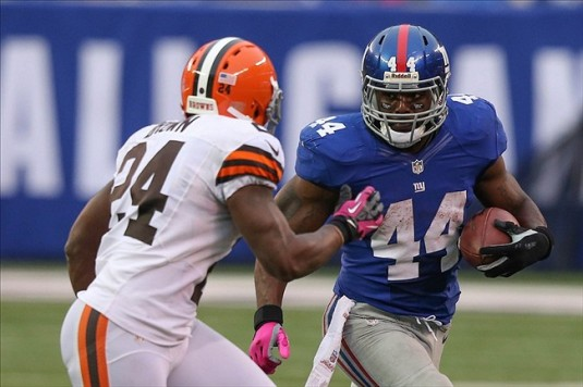 Oct 7, 2012; East Rutherford, NJ, New York Giants running back Ahmad Bradshaw (44) carries as Cleveland Browns running back Chris Ogbonnaya (25) closes in during the fourth quarter at MetLife Stadium. Giants won 41-27. Mandatory Credit: Anthony Gruppuso-US PRESSWIRE