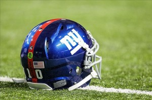 Dec 16, 2012; Atlanta, GA, USA; New York Giants quarterback Eli Manning (10) wears a decal on his helmet in memory of the Sandy Hook Elementary School shootings in Newtown, CT. before the game against the Atlanta Falcons at the Georgia Dome. Mandatory Credit: Daniel Shirey-USA TODAY Sports