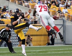 Aug 10, 2013; Pittsburgh, PA, USA; Pittsburgh Steelers punter Drew Butler (9) has his punt blocked by New York Giants defensive end Damontre Moore (79) during the first quarter at Heinz Field. Mandatory Credit: Jason Bridge-USA TODAY Sports