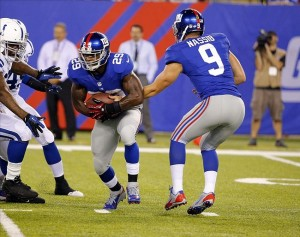 Aug 18, 2013; East Rutherford, NJ, USA; New York Giants quarterback Ryan Nassib (9) hands the ball off to running back Michael Cox (29) during the second half against the Indianapolis Colts at MetLife Stadium. Indianapolis Colts defeat the New York Giants 20-12. Mandatory Credit: Jim O
