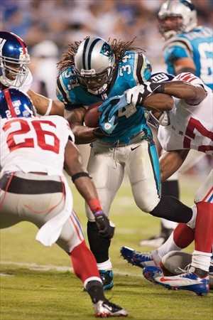 Sep 20, 2012; Charlotte, NC, USA Carolina Panthers running back DeAngelo Williams (34) runs up the middle during the third quarter against the New York Giants at Bank of America Stadium. The Giants defeated the Panthers 36-7. Mandatory Credit: Jeremy Brevard-USA TODAY Sports