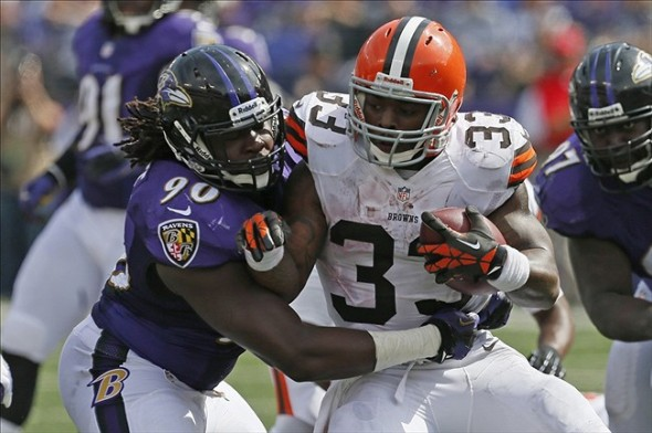 Sep 15, 2013; Baltimore, MD, USA; Cleveland Browns running back Trent Richardson (33) tackled by Baltimore Ravens linebacker Pernell McPhee (90) at M
