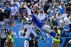 Sep 22, 2013; Charlotte, NC, USA; New York Giants cornerback Aaron Ross (31) breaks up a pass in the end zone intended for Carolina Panthers wide receiver Ted Ginn (19) in the second quarter at Bank of America Stadium. Mandatory Credit: Bob Donnan-USA TODAY Sports