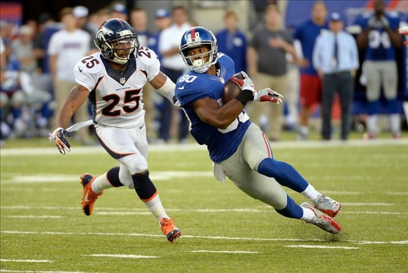 Sep 15, 2013; East Rutherford, NJ, USA; New York Giants wide receiver Victor Cruz (80) runs past Denver Broncos cornerback Chris Harris (25) during the game at MetLife Stadium. Mandatory Credit: Robert Deutsch-USA TODAY Sports