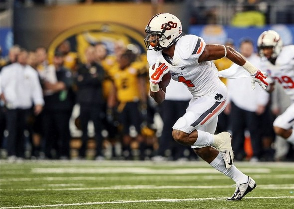 Jan 3, 2014; Arlington, TX, USA; Oklahoma State Cowboys cornerback Justin Gilbert (4) intercepts a pass and runs up the field during the game against the Missouri Tigers in the 2014 Cotton Bowl at AT