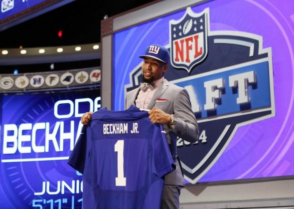 May 8, 2014; New York, NY, USA; Odell Beckham Jr. (LSU) holds up a jersey after being selected as the number twelve overall pick in the first round of the 2014 NFL Draft to the New York Giants at Radio City Music Hall. Mandatory Credit: Adam Hunger-USA TODAY Sports