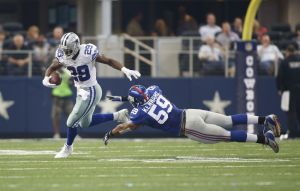 Oct 19, 2014; Arlington, TX, USA; Dallas Cowboys running back DeMarco Murray (29) breaks a tackle of New York Giants outside linebacker Devon Kennard (59) in the second quarter at AT&T Stadium. Mandatory Credit: Tim Heitman-USA TODAY Sports
