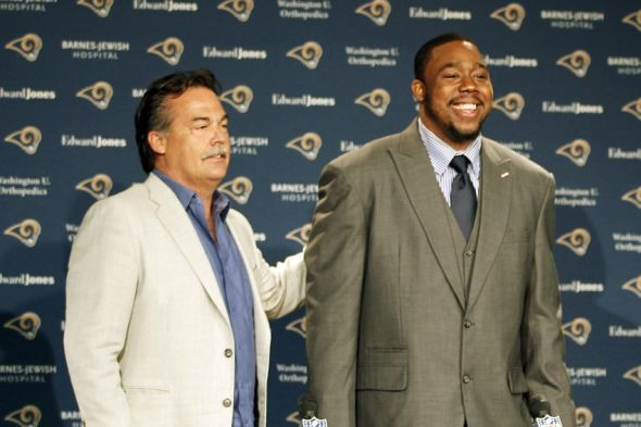 Mar 13, 2015; St. Louis, MO, USA; St. Louis Rams head coach Jeff Fisher (left) introduces newly acquired defensive tackle Nick Fairley to the media at Rams Park. Mandatory Credit: Billy Hurst-USA TODAY Sports