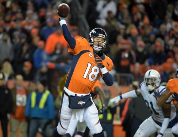 Jan 11, 2015; Denver, CO, USA; Denver Broncos quarterback Peyton Manning (18) throws a pass during the NFL divisional playoff game against the Indianapolis Colts at Sports Authority Field at Mile High Stadium. The Colts defeated the Broncos 24-13. Mandatory Credit: Kirby Lee-USA TODAY Sports