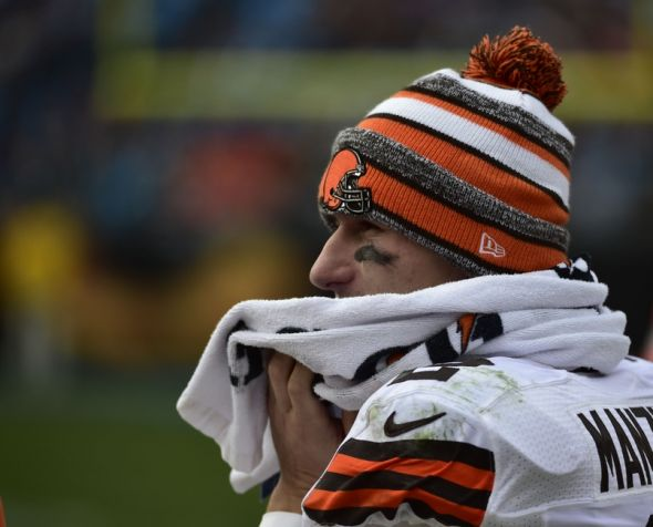 Dec 21, 2014; Charlotte, NC, USA; Cleveland Browns quarterback Johnny Manziel (2) on the sidelines in the third quarter at Bank of America Stadium. Mandatory Credit: Bob Donnan-USA TODAY Sports