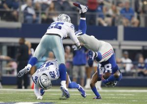 Oct 19, 2014; Arlington, TX, USA; New York Giants rtight end Larry Donnell (84) is tackled after a reception by Dallas Cowboys linebacker Rolando McClain (55) and safety Barry Church (42) at AT&T Stadium. Mandatory Credit: Matthew Emmons-USA TODAY Sports