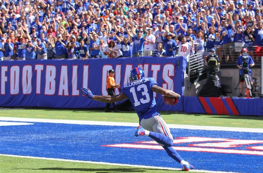 Sep 20, 2015; East Rutherford, NJ, USA; New York Giants wide receiver Odell Beckham Jr. (13) runs for a touchdown during the first half of their game against the Atlanta Falcons at MetLife Stadium. Mandatory Credit: Ed Mulholland-USA TODAY Sports