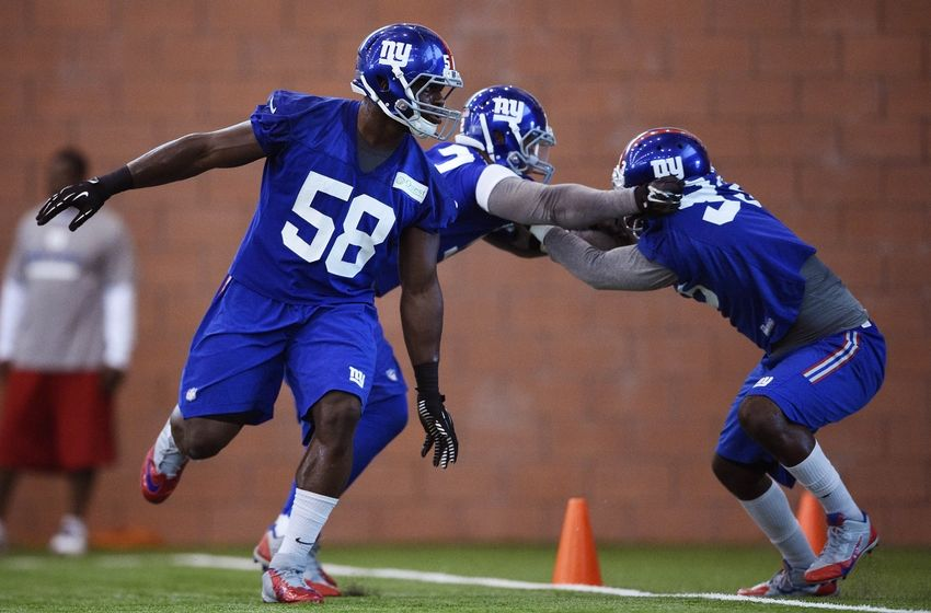 Jun 16, 2015; East Rutherford, NJ, USA; New York Giants defensive end Owa Odighizuwa (58) takes part in practice during minicamp at Quest Diagnostics Training Center. Mandatory Credit: Steven Ryan-USA TODAY Sports