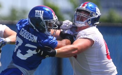 Jun 6, 2016; East Rutherford, NJ, USA; New York Giants linebacker B.J. Goodson (93) rushes New York Giants center Brett Jones (69) during organized team activities at Quest Diagnostics Training Center. Mandatory Credit: Ed Mulholland-USA TODAY Sports