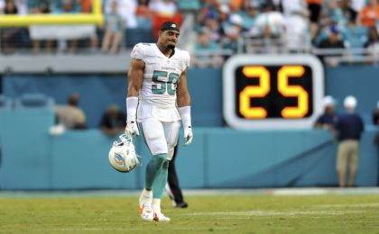 Sep 27, 2015; Miami Gardens, FL, USA; Miami Dolphins defensive end Olivier Vernon (50) walks off the field during the second half against the Buffalo Bills at Sun Life Stadium. Mandatory Credit: Steve Mitchell-USA TODAY Sports