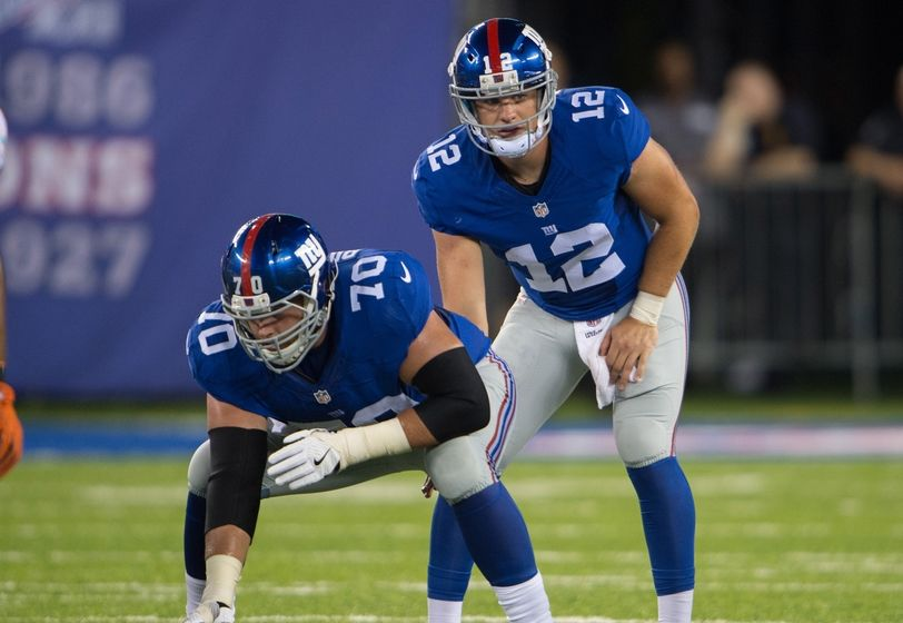 Aug 12, 2016; East Rutherford, NJ, USA;New York Giants quarterback Ryan Nassib (12) and New York Giants center Weston Richburg (70) in the first half at MetLife Stadium. Mandatory Credit: William Hauser-USA TODAY Sports
