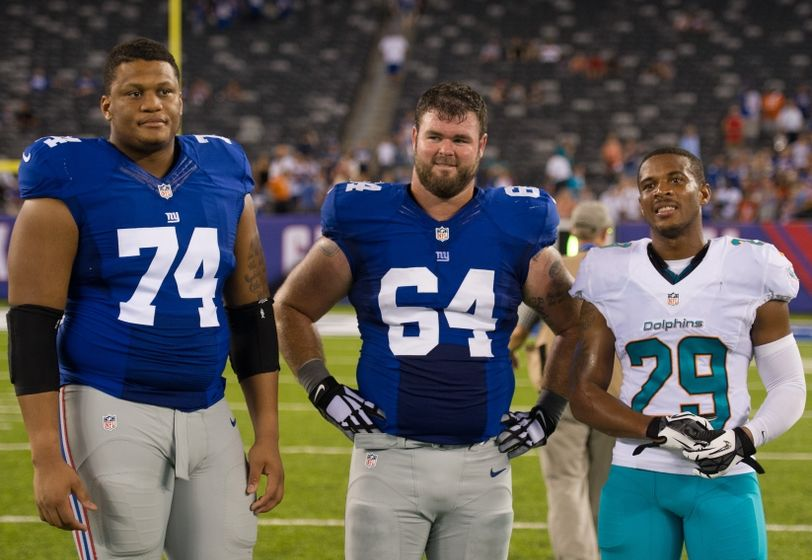 Aug 12, 2016; East Rutherford, NJ, USA; Miami Dolphins defensive back Chris Culliver (29) New York Giants center Shane McDermott (64) and New York Giants offensive tackle Ereck Flowers (74) after the game at MetLife Stadium. The Miami Dolphins defeat the New York Giants 27-10. Mandatory Credit: William Hauser-USA TODAY Sports