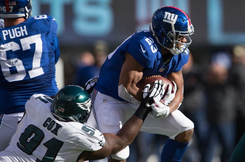 Nov 6, 2016; East Rutherford, NJ, USA; Philadelphia Eagles defensive tackle Fletcher Cox (91) tackles New York Giants running back Rashad Jennings (23) during the first half at MetLife Stadium. Mandatory Credit: William Hauser-USA TODAY Sports