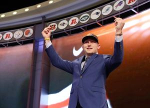 May 8, 2014; New York, NY, USA; Johnny Manziel (Texas A&M) gestures on stage after being selected as the number twenty-two overall pick in the first round of the 2014 NFL Draft to the Cleveland Browns at Radio City Music Hall. Mandatory Credit: Adam Hunger-USA TODAY Sports