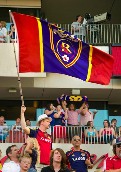 July 20, 2013; Sandy, UT, USA; A fan waves a Real Salt Lake flag during the first half of the Sporting KC-Real Salt Lake game at Rio Tinto Stadium. Mandatory Credit: Douglas C. Pizac-USA TODAY Sports