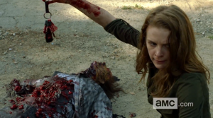 Karina finds keys on a downed walker from The Walking Dead webisode Alone from The Oath series.