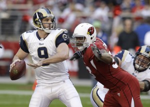 Cards Calais Campbell is about to sack Rams quarterback Keith Null (photo courtesy St. Louis Post-Dispatch)
