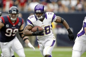 Dec 23, 2012; Houston, TX, USA; Minnesota Vikings running back Adrian Peterson (28) runs the ball against the Houston Texans in the first quarter at Reliant Stadium. Mandatory Credit: Brett Davis-USA TODAY Sports