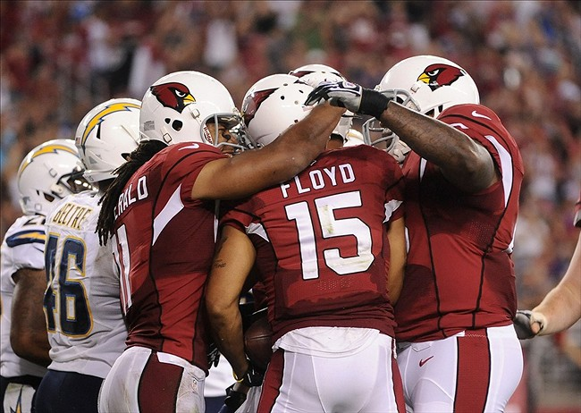 Aug 24, 2013; Phoenix, AZ, USA; Arizona Cardinals wide receiver Michael Floyd (15) celebrates with teammates after scoring in the second half of a preseason game against the San Diego Chargers at University of Phoenix Stadium. Mandatory Credit: Jennifer Stewart-USA TODAY Sports