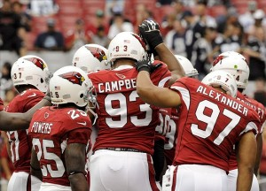 Aug 17, 2013; Phoenix, AZ, USA; Arizona Cardinals cornerback Jerraud Powers (25) defensive end Calais Campbell (93) and outside linebacker Lorenzo Alexander (97) huddle up during warm-ups against the Dallas Cowboys at University of Phoenix Stadium. Mandatory Credit: Casey Sapio-USA TODAY Sports