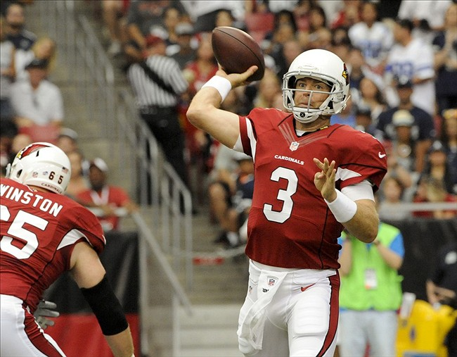 Aug 17, 2013; Phoenix, AZ, USA; Arizona Cardinals quarterback Carson Palmer (3) throws a pass during the first quarter against the Dallas Cowboys at University of Phoenix Stadium. Mandatory Credit: Casey Sapio-USA TODAY Sports