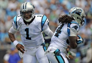 Sep 8, 2013; Charlotte, NC, USA; Carolina Panthers quarterback CaM Newton (1) hands off to running back DeAngelo Williams (34) during the game against the Seattle Seahawks at Bank of America Stadium. Mandatory Credit: Sam Sharpe-USA TODAY Sports