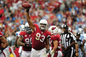 Sep 15, 2013; Phoenix, AZ, USA; Arizona Cardinals defensive tackle Calais Campbell (93) holds up the ball after recovering the fumbled ball in the third quarter against the Detroit Lions at University of Phoenix Stadium. Mandatory Credit: Jennifer Hilderbrand-USA TODAY Sports