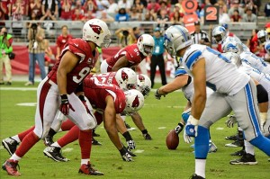 Sep 15, 2013; Phoenix, AZ, USA; The Arizona Cardinals defensive line squares off against the Detroit Lions offense during the second half at University of Phoenix Stadium. Mandatory Credit: Matt Kartozian-USA TODAY Sports