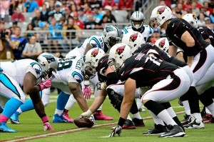Oct 6, 2013; Phoenix, AZ, USA; The Arizona Cardinals offensive line squares off against the Carolina Panthers defensive line during the first half at University of Phoenix Stadium. Mandatory Credit: Matt Kartozian-USA TODAY Sports
