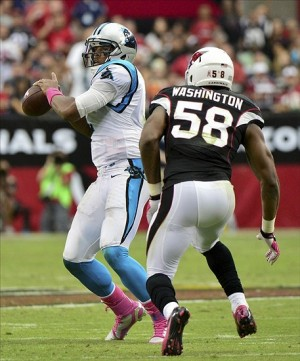 Oct 6, 2013; Phoenix, AZ, USA; Carolina Panthers quarterback Cam Newton (1) throws while under pressure from Arizona Cardinals linebacker Daryl Washington (58) during the second half at University of Phoenix Stadium. Mandatory Credit: Matt Kartozian-USA TODAY Sports