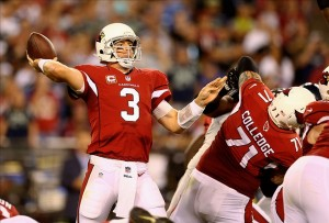 Oct 17, 2013; Phoenix, AZ, USA; Arizona Cardinals quarterback Carson Palmer throws a pass in the first half against the Seattle Seahawks at University of Phoenix Stadium. Mandatory Credit: Mark J. Rebilas-USA TODAY Sports
