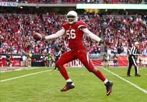 Dec 8, 2013; Phoenix, AZ, USA; Arizona Cardinals linebacker Karlos Dansby (56) returns an interception for a touchdown in the third quarter against the St. Louis Rams at University of Phoenix Stadium. The Cardinals defeated the Rams 30-10. Mandatory Credit: Mark J. Rebilas-USA TODAY Sports