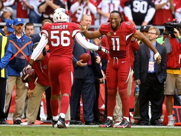 Dec 8, 2013; Phoenix, AZ, USA; Arizona Cardinals linebacker Karlos Dansby (56) celebrates with wide receiver Larry Fitzgerald (11) after returning an interception for a touchdown in the third quarter against the St. Louis Rams at University of Phoenix Stadium. The Cardinals defeated the Rams 30-10. Mandatory Credit: Mark J. Rebilas-USA TODAY Sports