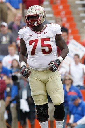 Nov 30, 2013; Gainesville, FL, USA; Florida State Seminoles offensive linesman Cameron Erving (75) against the Florida Gators during the first quarter at Ben Hill Griffin Stadium. Mandatory Credit: Kim Klement-USA TODAY Sports