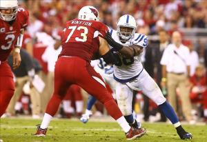Nov 24, 2013; Phoenix, AZ, USA; Indianapolis Colts linebacker Robert Mathis (98) against Arizona Cardinals offensive tackle Eric Winston (73) at University of Phoenix Stadium. The Cardinals defeated the Colts 40-11. Mandatory Credit: Mark J. Rebilas-USA TODAY Sports