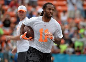 January 25, 2014; Honolulu, HI, USA; Arizona Cardinals receiver Larry Fitzgerald (11) takes the handoff from San Diego Chargers quarterback Philip Rivers (17) during the 2014 Pro Bowl Ohana Day at Aloha Stadium. Mandatory Credit: Kirby Lee-USA TODAY Sports