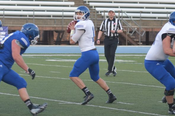 DAILY PENINSULA/Brandon Folsom -- Hillsdale College sophomore quarterback Mark LaPrairie drops back for a pass during the team's annual spring game on Thursday, April 17, 2014.