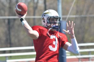 DAILY PENINSULA/Brandon Folsom -- Siena Heights quarterback Travis Zajkowski warms up prior to the team's annual spring game on Saturday, April 26, 2014 at O'Laughlin Stadium.