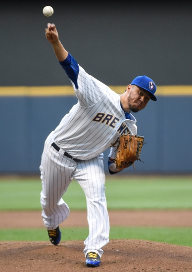 Jun 3, 2014; Milwaukee, WI, USA; Milwaukee Brewers pitcher Yovani Gallardo (49) pitches in the first inning against the Minnesota Twins at Miller Park. Mandatory Credit: Benny Sieu-USA TODAY Sports