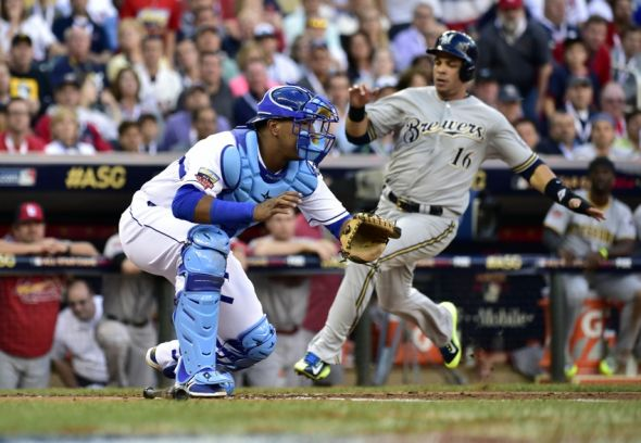 Jul 15, 2014; Minneapolis, MN, USA; National League infielder Aramis Ramirez (16) of the Milwaukee Brewers scores a run past American League catcher Salvador Perez (13) of the Kansas City Royals in the second inning during the 2014 MLB All Star Game at Target Field. Mandatory Credit: Scott Rovak-USA TODAY Sports