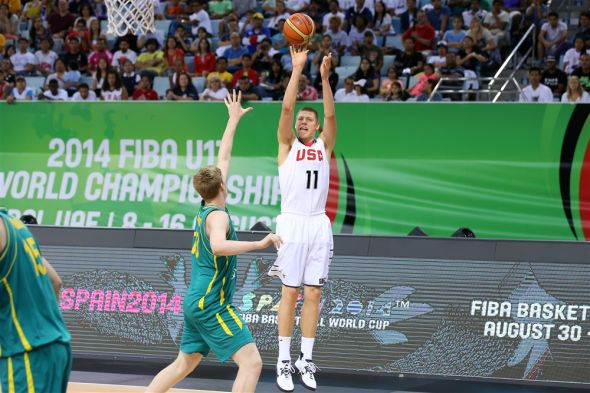 Henry Ellenson (11) takes a shot over Australia's Harry Froling Saturday in the gold medal game of the FIBA U17 World Championships in Dubai, United Arab Emirates. The rising senior at Rice Lake High School averaged 8.7 points per game for the gold-medal winning U.S. squad. (FIBA photo)