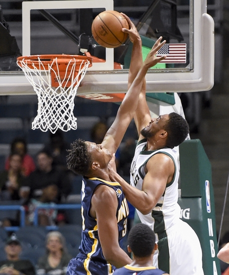 9619308-myles-turner-jabari-parker-nba-preseason-indiana-pacers-milwaukee-bucks