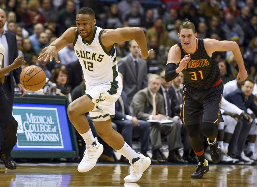 9734894-jabari-parker-mike-muscala-nba-atlanta-hawks-milwaukee-bucks