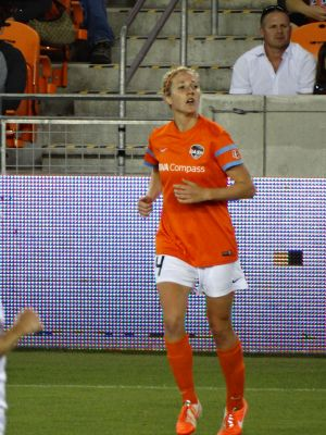 Becky Edwards sporting a Dash shirt with BBVA Compass sponsorship. Mandatory credit: Hal Kaiser